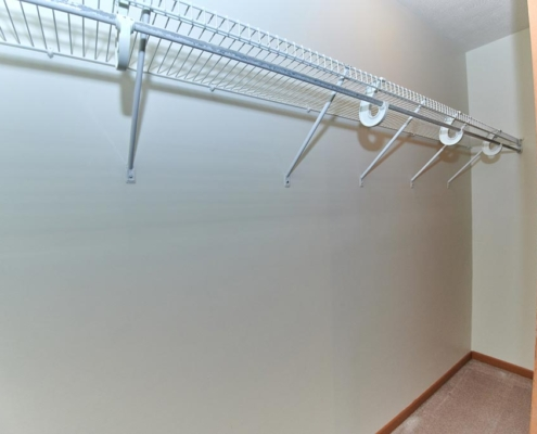 Closet detail in bedroom at PineView Apartments